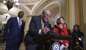 Senate Majority Leader Chuck Schumer, D-N.Y., flanked by Sen. Raphael Warnock, D-Ga., left, and Sen. Amy Klobuchar, D-Minn., speaks with reporters before a key test vote on the For the People Act, a sweeping bill that would overhaul the election system and voting rights, at the Capitol in Washington, Tuesday, June 22, 2021. The bill is a top priority for Democrats seeking to ensure access to the polls and mail-in ballots, but it is opposed by Republicans as a federal overreach. (AP Photo/J. Scott Applewhite) **FILE**