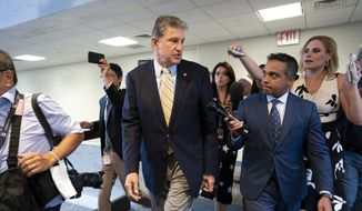 Sen. Joe Manchin, D-W.Va., a key negotiator in the infrastructure talks, is followed by reporters after a closed-door meeting on Capitol Hill with other Democrats in the bipartisan talks, in Washington, Tuesday, June 22, 2021. Congressional negotiators and the White House appear open to striking a roughly $1 trillion deal on infrastructure, but they are struggling with the hard part — deciding who will pay for it. (AP Photo/J. Scott Applewhite)