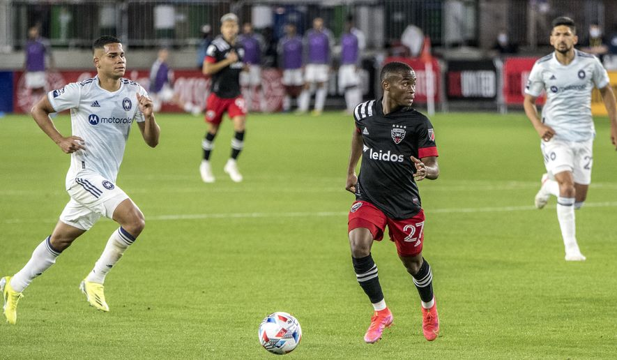 Moses Nyeman splits defenders looking for a cross from D.C. United vs. Chicago Fire at Audi Field on May 15. (All-Pro Reels Photography)