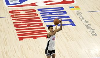 Maryland's Aaron Wiggins shoots as he participates in the NBA Draft Combine at the Wintrust Arena Tuesday, June 22, 2021, in Chicago. (AP Photo/Charles Rex Arbogast) **FILE**