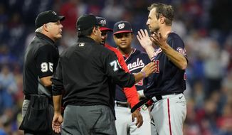 Washington Nationals pitcher Max Scherzer, right, is checked for foreign substances during the middle of the fourth inning of a baseball game against the Philadelphia Phillies, Tuesday, June 22, 2021, in Philadelphia. (AP Photo/Matt Slocum)