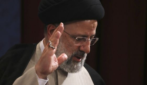 In this June 21, 2021, photo, Iran's new President-elect Ebrahim Raisi waves at the conclusion of his news conference in Tehran, Iran. Biden administration officials are insisting that the election of a hard-liner as Iran's president won't affect prospects for reviving the faltering 2015 nuclear deal with Tehran. But there are already signs that their goal of locking in a deal just got harder. (AP Photo/Vahid Salemi) ** FILE **