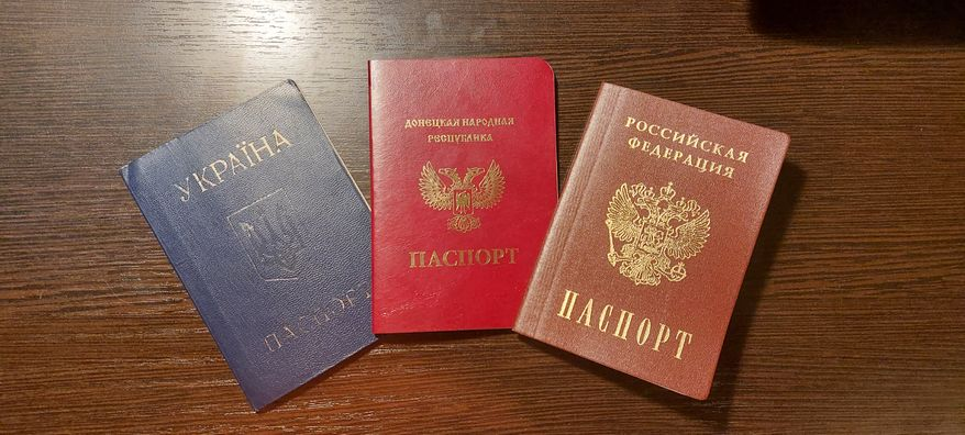 Ukrainian (blue), Donetsk People's Republic (bright red), and Russian passports are shown here. Photo: ARA Network