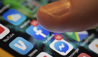 In this Aug. 11, 2019, file photo, an iPhone displays multiple apps in New Orleans. When U.S. law enforcement officials are fishing for information, they increasingly know where to go — in the vast digital ponds of personal data that Big Tech companies have created in their devices and online services that have hooked billions of people around the world. (AP Photo/Jenny Kane, File)