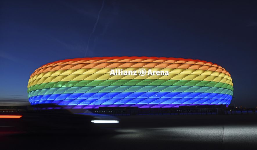 Munich's stadium is illuminated in rainbow colors on the occasion of Christopher Street Day in Munich, Germany, Saturday, July 9, 2016. UEFA has declined the Munich city council's application to have its stadium illuminated in rainbow colors for Germany's final Euro 2020 group game against Hungary on Wednesday, June 23, 2021. (Tobias Hase/dpa via AP)