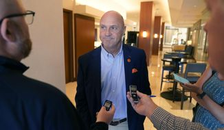 Clemson University President Jim Clements listens to a reporters question after the College Football Playoff presidents group meeting Tuesday, June 22, 2021, in Grapevine, Texas. The CFP met to discuss a proposed plan to expand the postseason format from four to 12 teams. (AP Photo/LM Otero)