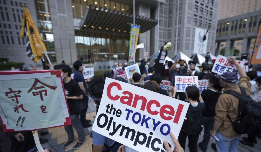 People against the July opening of the Tokyo 2020 Olympics, gather to protest around the Tokyo Metropolitan Government building during a demonstration Wednesday, June 23, 2021, in Tokyo. (AP Photo/Eugene Hoshiko)