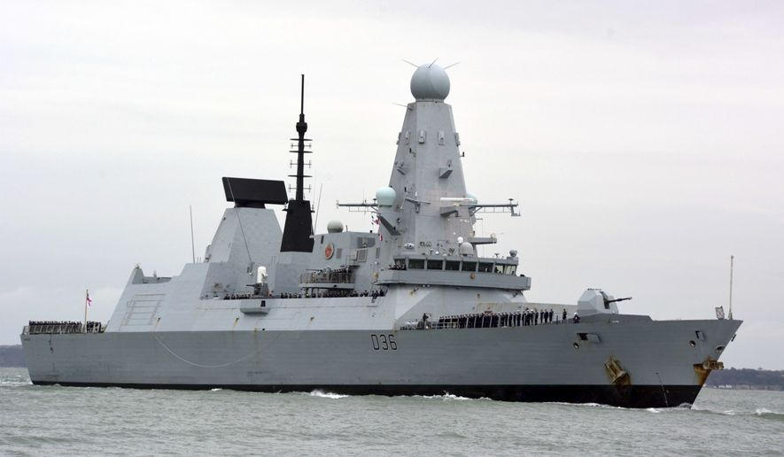This March 20, 2020, file photo shows HMS Defender in Portsmouth, England. The Russian military says its warship has fired warning shots and a warplane dropped bombs to force the British destroyer from Russia's waters near Crimea in the Black Sea. The incident on Wednesday June 23, 2021, marks the first time since the Cold War era when Moscow used live ammunition to deter a NATO warship, reflecting soaring Russia-West tensions. (Ben Mitchell/PA via AP, File)