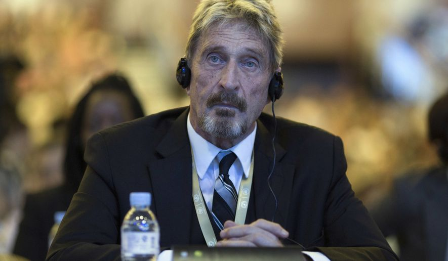 In this Tuesday, Aug. 16, 2016 file photo, software entrepreneur John McAfee listens during the 4th China Internet Security Conference (ISC) in Beijing. McAfee, the creator of the McAfee antivirus software, was found dead in a prison near Barcelona Wednesday, June 23, 2021, hours after Spain's National Court approved his extradition to the to the United States, where he was wanted on tax-related criminal charges. He was 75. (AP Photo/Ng Han Guan, File)