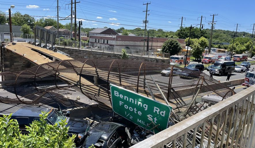 A collapsed pedestrian bridge over Kenilworth Avenue (DC-295) in Northeast D.C. is shown in this D.C. Fire and Emergency Medical Services photograph. (DC FEMS) [https://twitter.com/dcfireems/status/1407742978907676678]