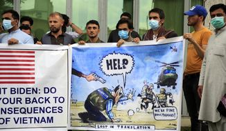 In this Friday, April 30, 2021, photo, former Afghan interpreters hold banners during a protest against the U.S. government and NATO in Kabul, Afghanistan. With American troops withdrawing from Afghanistan, pressure has been mounting for the Biden administration to plan a military evacuation of Afghans who supported U.S. military operations during two decades of war in their country. (AP Photo/Mariam Zuhaib) **FILE**