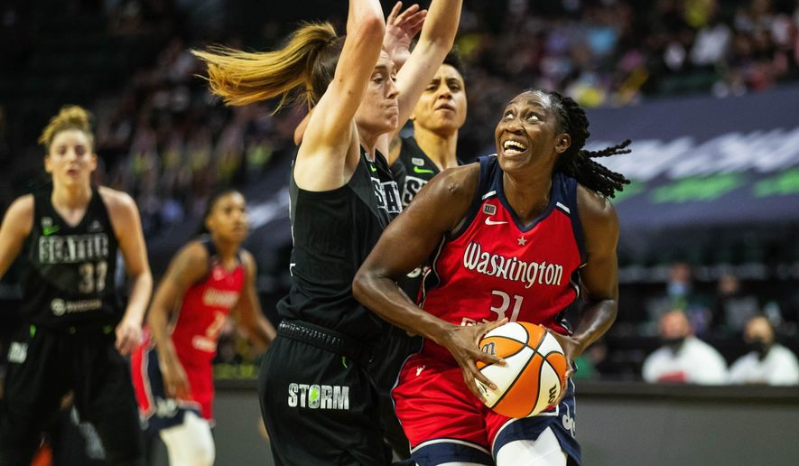 Seattle Storm's Breanna Stewart, left, defends Washington Mystics' Tina Charles (31) during the first half of a WNBA basketball game, Tuesday, June 22, 2021 in Everett, Wash. (Dean Rutz/The Seattle Times via AP) **FILE**