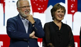 Incoming Southern Baptist Convention President Ed Litton, left, and his wife, Kathy Litton, listen as outgoing President J. D. Greear makes remarks at the conclusion of the annual Southern Baptist Convention meeting Wednesday, June 16, 2021, in Nashville, Tenn. (AP Photo/Mark Humphrey)
