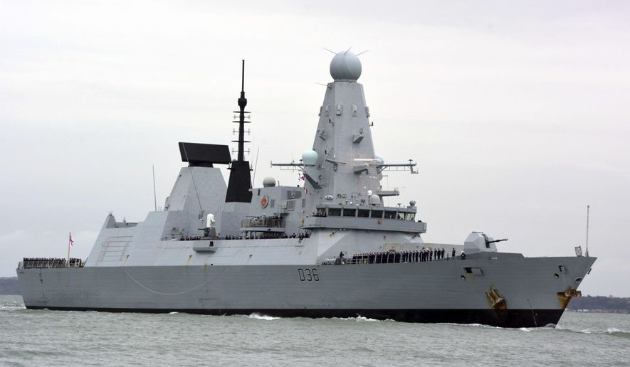 This March 20, 2020, photo shows HMS Defender in Portsmouth, England. The Russian military says its warship has fired warning shots and a warplane dropped bombs to force the British destroyer from Russia's waters near Crimea in the Black Sea. The incident on Wednesday June 23, 2021, marks the first time since the Cold War era when Moscow used live ammunition to deter a NATO warship, reflecting soaring Russia-West tensions. (Ben Mitchell/PA via AP) **FILE**