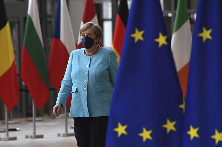 Germany's Chancellor Angela Merkel arrives for an EU summit at the European Council building in Brussels, Thursday, June 24, 2021. At their summit in Brussels, EU leaders are set to take stock of coronavirus recovery plans, study ways to improve relations with Russia and Turkey, and insist on the need to develop migration partners with the countries of northern Africa, but a heated exchange over a new LGBT bill in Hungary is also likely. (John Thys, Pool Photo via AP)