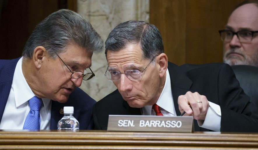 Sen. Joe Manchin, D-W.Va., chair of the Senate Energy and Natural Resources Committee holds a hearing with Ranking Member Sen. John Barrasso, R-Wyo., right, on infrastructure needs of the U.S. energy sector, western water and public lands, at the Capitol in Washington, Wednesday, June 23, 2021. Manchin and other Senate infrastructure negotiators are meeting with President Joe Biden at the White House later today. (AP Photo/J. Scott Applewhite)