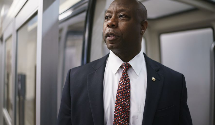 In this May 27, 2021, file photo Sen. Tim Scott, R-S.C., arrives as senators go to the chamber for votes ahead of the approaching Memorial Day recess, at the Capitol in Washington. Mr. Scott is involved in bipartisan negotiations on a police-reform package.  (AP Photo/J. Scott Applewhite, File)  **FILE**