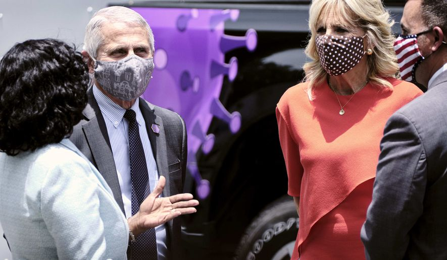 First lady Jill Biden and Dr. Anthony Fauci, director of the National Institute of Allergy and Infectious Diseases, talk with patients at a drive-through COVID-19 vaccination site at Osceola Community Health Services in Kissimmee, Fla., on Thursday, June 24, 2021.  (T.J. Kirkpatrick/The New York Times via AP, Pool)