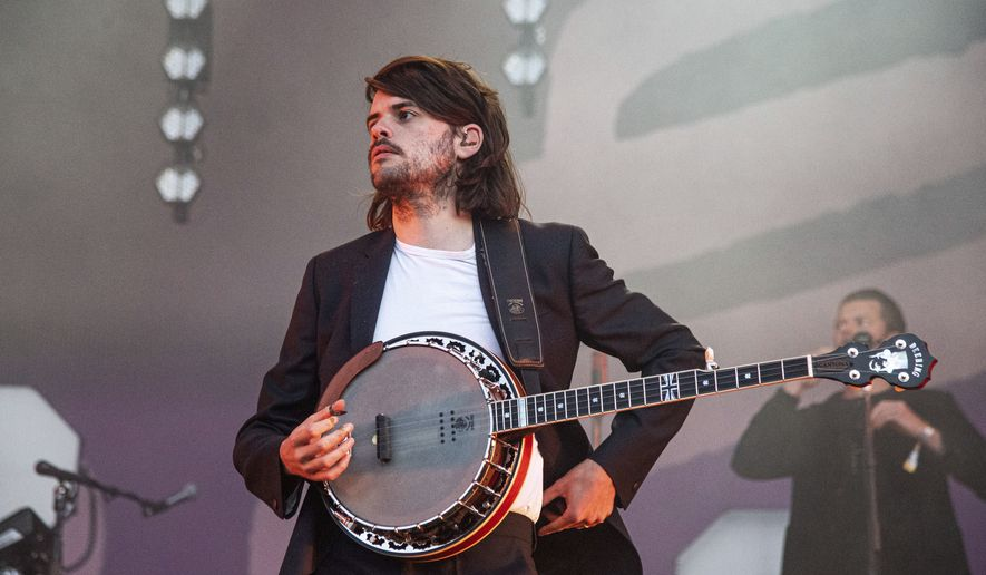 """In this Sunday, May 26, 2019 file photo, Winston Marshall of Mumford & Sons performs at the BottleRock Napa Valley Music Festival at Napa Valley Expo, in Napa, Calif. Marshall says he is leaving folk-rock group Mumford & Sons so that he can """"speak freely"""" about political issues. Marshall took a break from the band in March after sparking a social media storm by tweeting admiration for  a book by right-wing writer-activist Andy Ngo. Marshall was accused online of endorsing the far right, but said Thursday, June 24, 2021 that """"nothing could be further from the truth.""""( Photo by Amy Harris/Invision/AP, File)"""