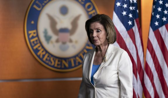 """House Speaker Nancy Pelosi of California departs after speaking during a media availability at the Capitol in Washington, Thursday, June 24, 2021. Pelosi announced on Thursday that she's creating a special committee to investigate the Jan. 6 attack on the Capitol, saying it is """"imperative that we seek the truth."""" (AP Photo/Alex Brandon)"""