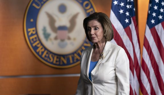 """House Speaker Nancy Pelosi of Calif., departs after speaking during a media availability at the Capitol in Washington, Thursday, June 24, 2021. Pelosi announced on Thursday that she's creating a special committee to investigate the Jan. 6 attack on the Capitol, saying it is """"imperative that we seek the truth."""" (AP Photo/Alex Brandon)"""