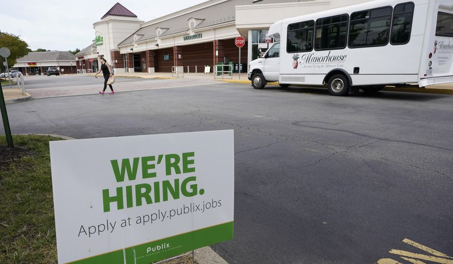 A We're Hiring sign at a Publix supermarket in Richmond, Va., Wednesday, June 2, 2021. The number of Americans applying for unemployment benefits rose last week, Thursday, June 17,  for the first time since April despite widespread evidence that the economy and the job market are rebounding steadily from the pandemic recession. (AP Photo/Steve Helber)
