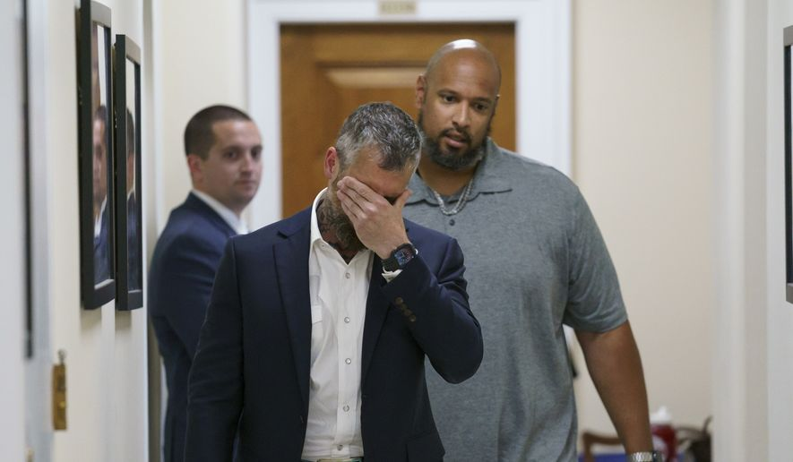 Michael Fanone, left, a Washington Metropolitan Police Department officer who was attacked and beaten during the Jan. 6, attack at the U.S. Capitol, and Harry Dunn, a U.S. Capitol Police officer who faced the rioters, leave a meeting with House Minority Leader Kevin McCarthy, R-Calif., at the Capitol in Washington, Friday, June 25, 2021. House Speaker Nancy Pelosi announced Thursday she's creating a special committee to investigate the attack by a mob of Trump supporters who sought to interrupt the certification of Joe Biden's presidential election victory. (AP Photo/J. Scott Applewhite)