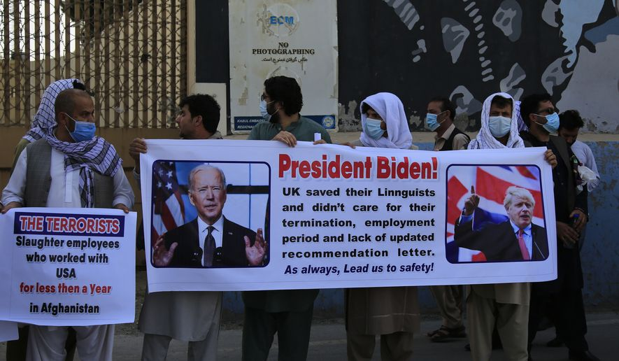 Former Afghan interpreters hold placards during a demonstrations against the U.S. government, in front of the US Embassy in Kabul, Afghanistan, Friday, June 25, 2021. (AP Photo/Mariam Zuhaib)