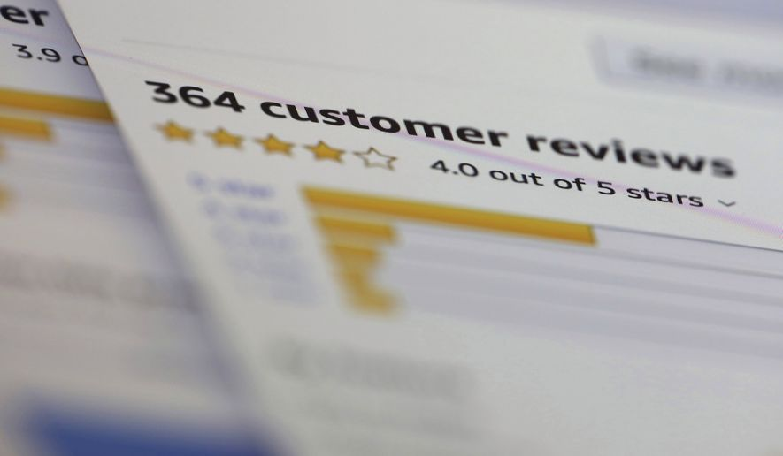 In this April 17, 2019, file photo online customer reviews for a product are displayed on a computer in New York. U.K. regulators are investigating Google and Amazon over concerns the online giants aren't doing enough to stop fake reviews of products and services on their platforms. The Competition and Markets Authority said Friday, June 25, 2021, it opened a formal investigation into whether the two companies broke U.K. consumer law by failing to protect shoppers. (AP Photo/Jenny Kane, File)