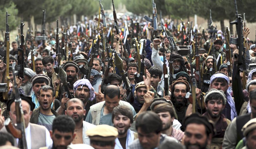 Afghan militiamen join Afghan defense and security forces during a gathering in Kabul, Afghanistan, Wednesday, June 23, 2021. The defense ministry is working with warlords to mobilize local militias across the country, most particularly in the north, to try to stem the tide of the latest Taliban gains. Several key districts in the north of the country have fallen to the Taliban. (AP Photo/Rahmat Gul)