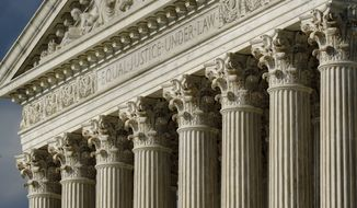 This June 8, 2021, photo shows the Supreme Court in Washington. (AP Photo/J. Scott Applewhite) **FILE**