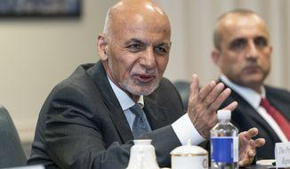 Afghan President Ashraf Ghani, left, speaks before a meeting with Secretary of Defense Lloyd Austin at the Pentagon in Washington, Friday, June 25, 2021. (AP Photo/Alex Brandon)