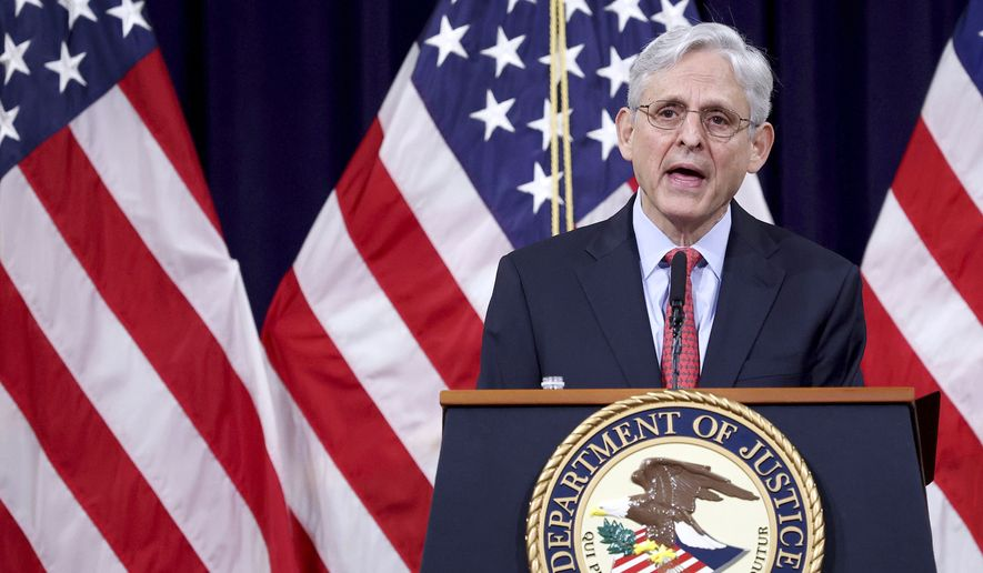 In this June 15, 2021, photo, Attorney General Merrick Garland speaks at the Justice Department in Washington. The Justice Department is suing Georgia over the state's voting laws, a person familiar with the matter said Friday, June 25. (Win McNamee/Pool via AP) ** FILE **