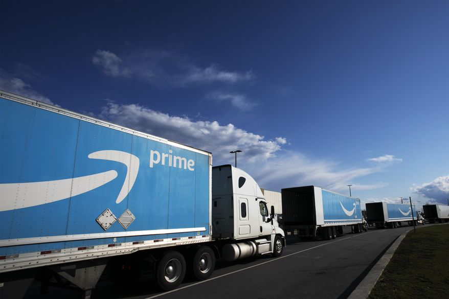 This April 21, 2020, file photo shows Amazon tractor-trailers line up outside the Amazon Fulfillment Center in the Staten Island borough of New York. (AP Photo/Mark Lennihan, File)