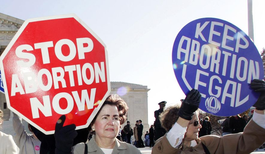 In this Nov. 30, 2005, file photo, an anti-abortion supporter stands next to a  pro-choice demonstrator outside the U.S. Supreme Court in Washington. (AP Photo/Manuel Balce Ceneta) ** FILE **