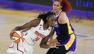 Washington Mystics center Tina Charles (31) is defended by Los Angeles Sparks center Amanda Zahui B during the first half of a WNBA basketball game Thursday, June 24, 2021, in Los Angeles.(AP Photo/Marcio Jose Sanchez) **FILE**