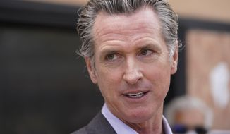 In this June 3, 2021, file photo California Gov. Gavin Newsom listens to questions during a news conference in San Francisco. Democrats in the state Legislature are trying to alter the state's recall laws in a move that would allow Newsom's election to be held earlier. They are expected to debate the proposal Monday, June 28, 2021. (AP Photo/Eric Risberg, File)