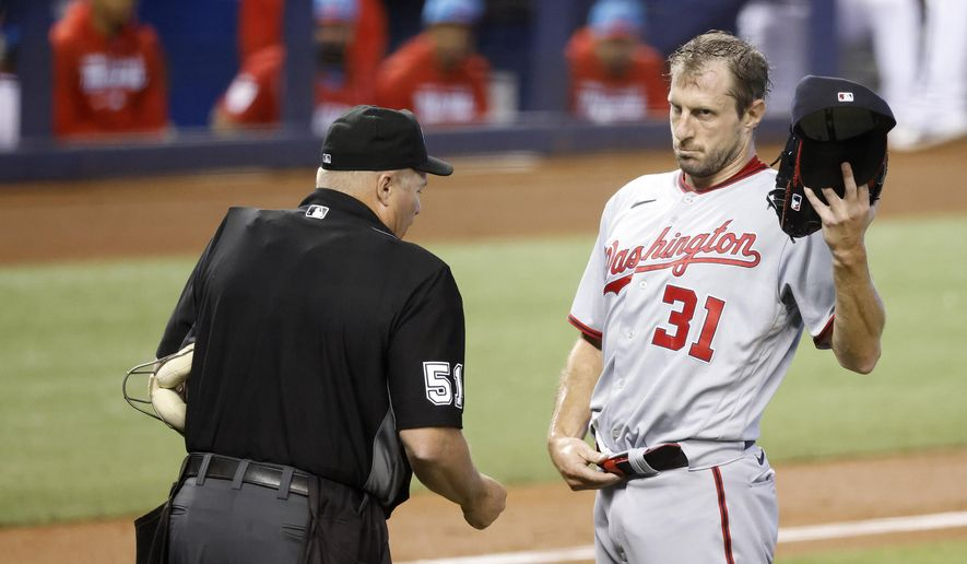 Washington Nationals starting pitcher Max Scherzer (31) is check for foreign substances by an umpire following the first inning of a baseball game against the Miami Marlins, Sunday, June 27, 2021, in Miami. (AP Photo/Rhona Wise) **FILE**
