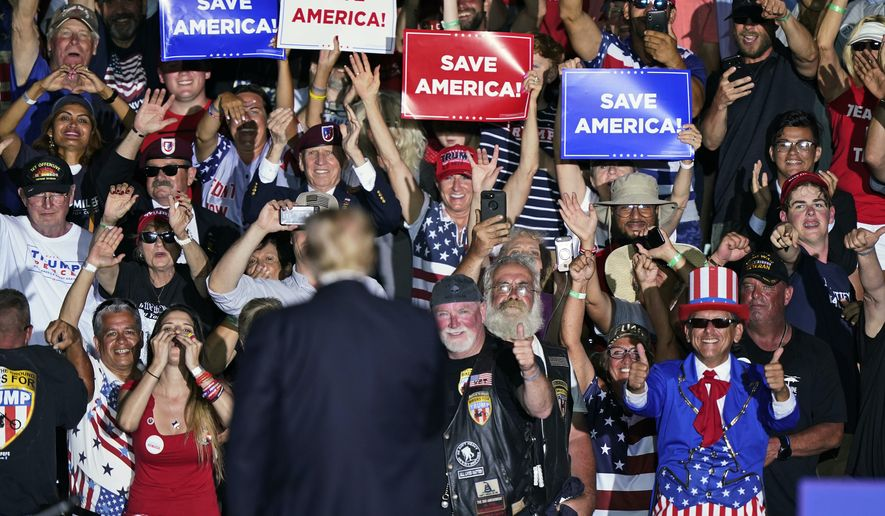 Supporters cheer on former President Donald Trump after he spoke at a rally at the Lorain County Fairgrounds, Saturday, June 26, 2021, in Wellington, Ohio. (AP Photo/Tony Dejak)