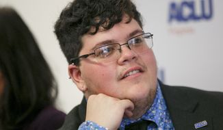 Gavin Grimm, who has become a national face for transgender students, speaks during a news conference held by the ACLU and the ACLU of Virginia at Slover Library in Norfolk, Va. The Supreme Court has rejected a Virginia school board's appeal to reinstate its transgender bathroom ban. Over two dissenting votes, the justices on Monday, June 28, 2021, left in place lower court rulings that found the policy unconstitutional. (Kristen Zeis/The Daily Press via AP, File)