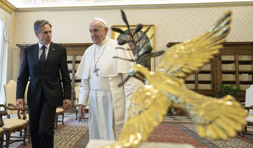 Pope Francis talks with Secretary of State Antony Blinken, as they meet at the Vatican, Monday, June 28, 2021. Blinken is on a weeklong trip in Europe traveling to Germany, France and Italy. (Vatican Media via AP Photo)