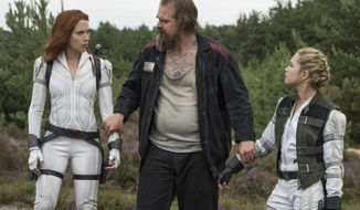 """This image released by Marvel Studios shows Scarlett Johansson, from left, David Harbour and Florence Pugh in a scene from """"Black Widow."""" (Jay Maidment/Marvel Studios-Disney via AP)"""