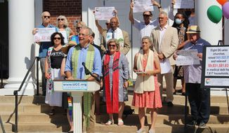 The Rev. Tim Tutt, flanked by clergy and representatives of the eight D.C. area churches. Photo by Samantha Steinfeld, courtesy of the United Church of Christ.