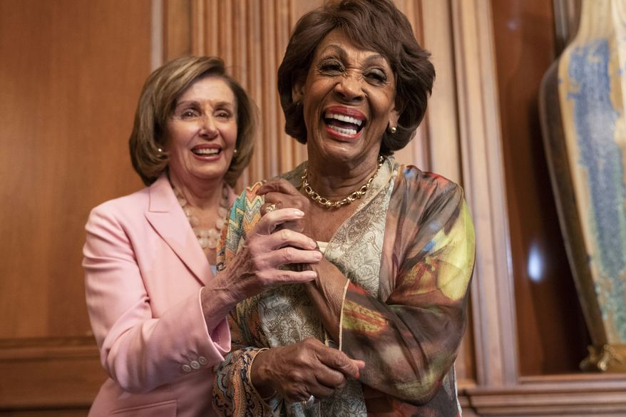 In this file photo, House Speaker Nancy Pelosi of Calif., left, and Rep. Maxine Waters, D-Calif., laugh after Waters told Pelosi a funny story, after Pelosi signed bill enrollments for Congressional Review Act Resolutions S. J. Res. 13, 14 and 15, Tuesday, June 29, 2021, on Capitol Hill in Washington. (AP Photo/Jacquelyn Martin)  **FILE**