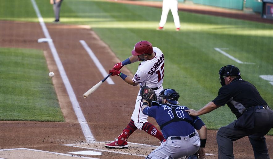 Washington Nationals' Kyle Schwarber hits a solo home run during the first inning of a baseball game against the Tampa Bay Rays at Nationals Park, Tuesday, June 29, 2021, in Washington. (AP Photo/Alex Brandon) **FILE**