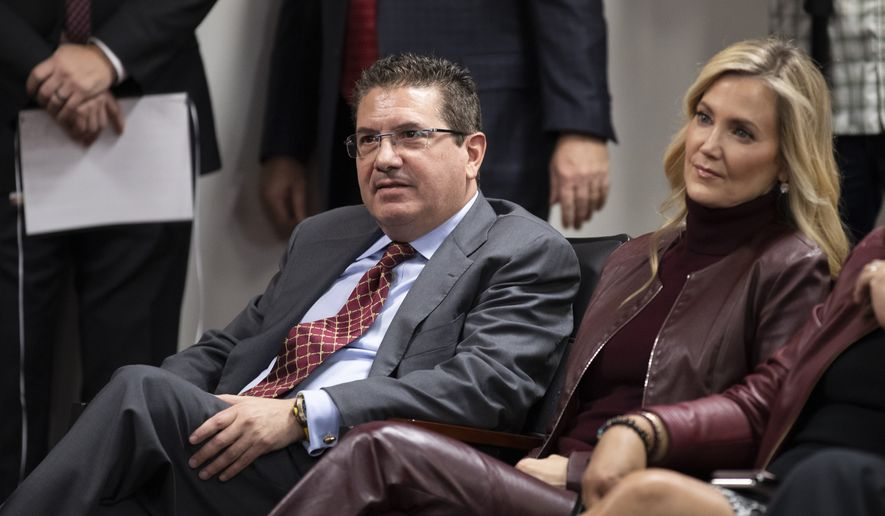 Washington Redskins owner Dan Snyder, left, and his wife Tanya Snyder, listen to head coach Ron Rivera during a news conference at the team's NFL football training facility in Ashburn, Va., in this Thursday, Jan. 2, 2020, file photo. Dan Snyders wife Tanya was named co-CEO of the Washington Football Team on Tuesday, June 29, 2021, giving her bigger influence in the club that is currently in the midst of an independent investigation into workplace conduct the NFL is overseeing. (AP Photo/Alex Brandon, File) **FILE**