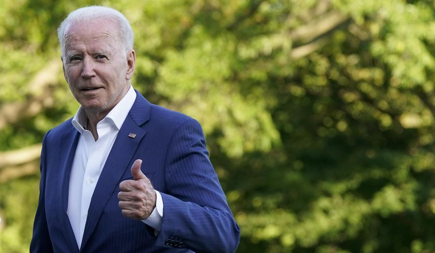 President Joe Biden gestures as he walks on the South Lawn of the White House after stepping off Marine One, Sunday, June 27, 2021, in Washington. Biden is returning from a weekend at Camp David. (AP Photo/Patrick Semansky)