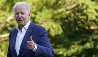 President Joe Biden gestures as he walks on the South Lawn of the White House after stepping off Marine One, Sunday, June 27, 2021, in Washington. Biden is returning from a weekend at Camp David. (AP Photo/Patrick Semansky/File)
