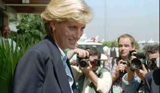 In this Thursday, Jan. 16, 1996, file photo, Britain's Princess Diana faces photographers as she leaves Luanda airport building to board a plane to Johannesburg at the end of her four-day visit to Angola. (AP Photo/Giovanni Deffidenti, File)