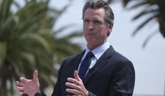 California Governor Gavin Newsom talks during a news conference at Universal Studios in Universal City, Calif., on Tuesday, June 15, 2021.   Newsom is at risk of being on the recall ballot without his party ID – Democrat – next to his name. Newsom's campaign is suing the Secretary of State, whom he appointed, after they failed to file paperwork on time. (AP Photo/Ringo H.W. Chiu)